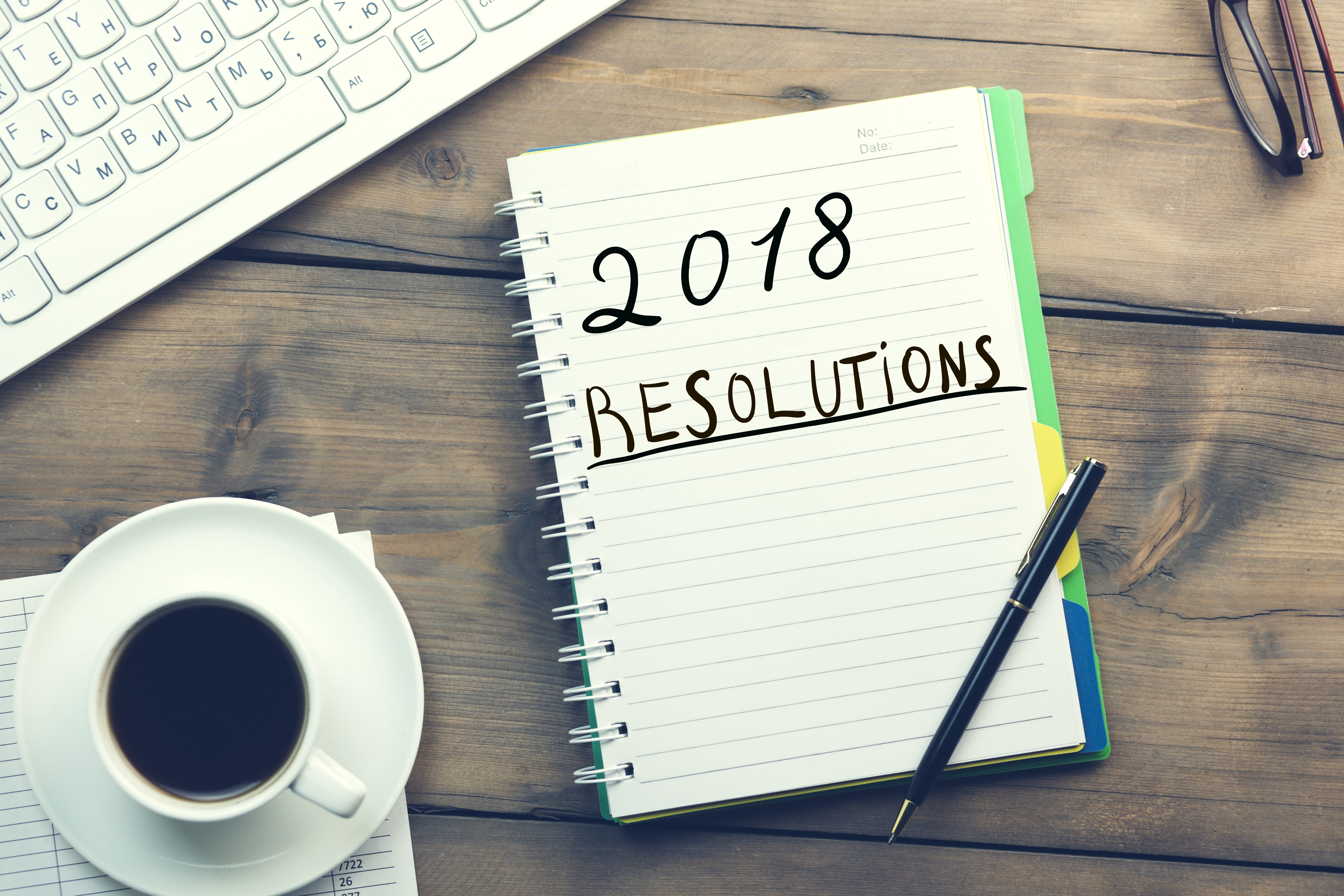 """Admissions marketer """"2018 resolutions"""" on a notepad, thinking about how to reach more of the right prospective students."""
