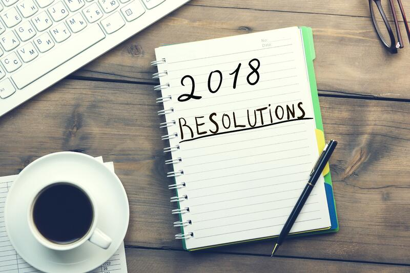 "Admissions marketer ""2018 resolutions"" on a notepad, thinking about how to reach more of the right prospective students."